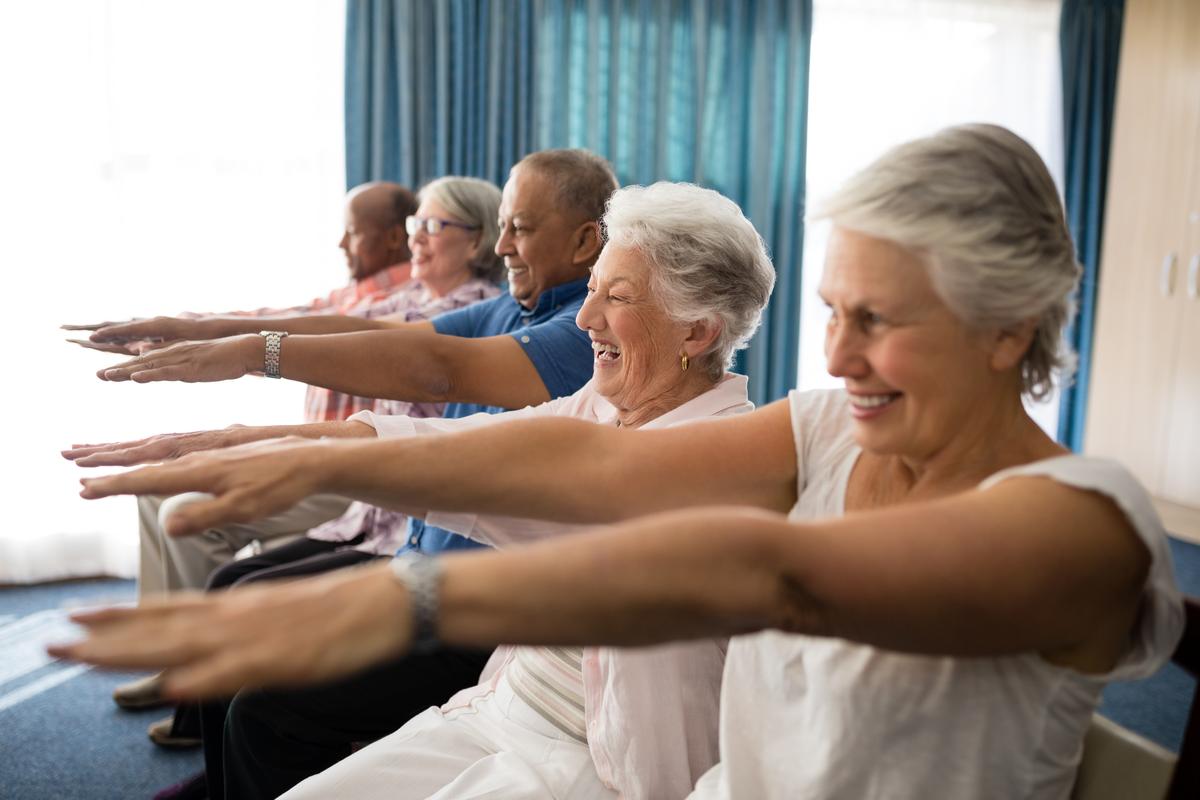 seniors in assisted living enjoying calisthenics